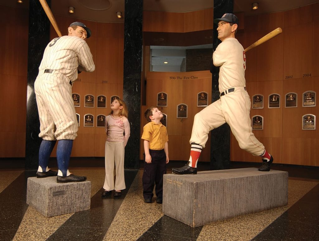 Kids looking at baseball player statues